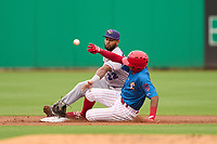 Fort Myers Mighty Mussels shortstop Jesus Feliz (22) glove is knocked off by Jadiel Sanchez (16) sliding in during a game against the Clearwater Threshers on July 29, 2021 at BayCare Ballpark in Clearwater, Florida.  (Mike Janes/Four Seam Images)