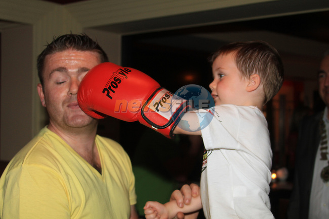 Liam O'Maley give dad Robert a box at the Launch of the White Collar boxing Fight Night in the West Court Hotel...Picture Fran Caffrey www.newsfile.ie