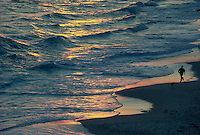 Man running on beach at Gay Head (Aquinnah), Martha's Vineyard, MA