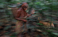 Carrying Fire..Pygmies carry fire wherever they go.  This is another strobe-blur photo because it was so dark.  The strobe scared the bejesus out of these folks... but they loved the back of the digi.. Paluku told me they've never seen a white guy before... but I really felt it when the small children screamed and dogs barked at me..