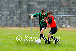 Tussle for possession between Tralee Dynamos Brendan Meehan and Fenit Samphire's Jack McCarthy in the U14 cup competition.