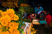 A Mexican flower market vendor, surrounded by her children, sell piles of marigold flowers (Flor de muertos) for Day of the Dead festivities in Oaxaca, Mexico, 30 October 2019. Day of the Dead (Día de Muertos), a religious holiday combining the death veneration rituals of Pre-Hispanic cultures with the Catholic practice, is widely celebrated throughout all of Mexico. Based on the belief that the souls of the departed may come back to this world on that day, people gather together while either praying or joyfully eating, drinking, and playing music, to remember friends or family members who have died and to support their souls on the spiritual journey.