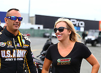 Jul. 28, 2013; Sonoma, CA, USA: NHRA top fuel dragster driver Brittany Force (right) walks with Tony Schumacher during the Sonoma Nationals at Sonoma Raceway. Mandatory Credit: Mark J. Rebilas-