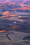 The pink sunrise reveals the freshly plowed wheat fields of the Palouse as seen from Steptoe Butte in Eastern Washington State.