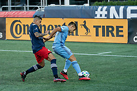 FOXBOROUGH, MA - SEPTEMBER 19: Nicolas Acevedo #26 of New York City FC keeps the ball from Gustavo Bou #7 of New England Revolution near the New York City goal during a game between New York City FC and New England Revolution at Gillette on September 19, 2020 in Foxborough, Massachusetts.
