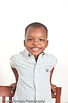closeup portrait of smiling 3 year old boy vertical