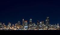 The Seattle skyline is shown from across Elliot Bay in Seattle Washington.