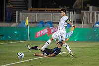 SAN JOSE, CA - SEPTEMBER 19: Eric Calvillo #26 of the San Jose Earthquakes and  Marco Farfan #32 of the Portland Timbers battle for the ball during a game between Portland Timbers and San Jose Earthquakes at Earthquakes Stadium on September 19, 2020 in San Jose, California.