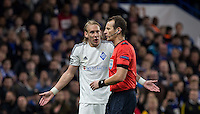 Domagoj Vida of Dynamo Kiev (Dynamo Kyiv) asks questions of the Referee during the UEFA Champions League Group G match between Chelsea and Dynamo Kyiv at Stamford Bridge, London, England on 4 November 2015. Photo by Andy Rowland.