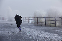 Martine Smith, 21, from Kilwinning picturedSaltcoats Railway Station on the West Coast of Scotland, the UK, is hit by severe storms. 8 December 2011. Picture by Guy Hinks/Universal News and Sport (Europe)
