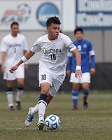 University of Connecticut midfielder Carlos Alvarez (10) brings the ball forward. .NCAA Tournament. Creighton University (blue) defeated University of Connecticut (white), 1-0, at Morrone Stadium at University of Connecticut on December 2, 2012.