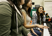 Canadian R&B singer Keshia Chanté chats with Killarney Secondary School choir students Carol Trinh (left) and Noreen Jamal (right). Chanté visited the school Monday, February 26 as part of the Rogers & Vervegirl  Magazine Love Music Speaking Tour in which she will speak to students at eight high schools across Canada about how music has positively influenced her life. (CNW GROUP/Rogers Communications)