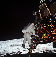 """20 July 1969) --- Astronaut Edwin E. Aldrin, Jr., lunar module pilot, descends the steps of the Lunar Module (LM) ladder as he prepares to walk on the Moon. He had just egressed the LM. This photograph was taken by astronaut Neil A. Armstrong, commander, with a 70mm lunar surface camera during the Apollo 11 extravehicular activity (EVA). While Armstrong and Aldrin descended in the LM """"Eagle"""" to explore the Moon, astronaut Michael Collins, command module pilot, remained with the Command and Service Modules (CSM) in lunar orbit."""