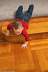 9 month old baby boy crawling down stairs