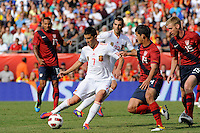 David Villa (7) of Spain is marked by Eric Lichaj (14) of the United States. The men's national team of Spain (ESP) defeated the United States (USA) 4-0 during a International friendly at Gillette Stadium in Foxborough, MA, on June 04, 2011.