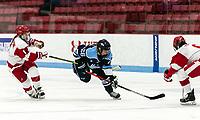 BOSTON, MA - JANUARY 04: Ida Kuoppala #26 of University of Maine brings the puck forward as Alexandra Calderone #4 of Boston University defends during a game between University of Maine and Boston University at Walter Brown Arena on January 04, 2020 in Boston, Massachusetts.
