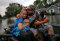 David Gonzalez comforts his wife Kathy after being rescued from their flooded home caused by Hurricane Harvey in Orange, Texas, U.S.A. on August 30, 2017.