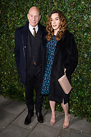 Sir Patrick Stewart and Sunny Ozell<br /> arriving for the 2018 Charles Finch & CHANEL Pre-Bafta party, Mark's Club Mayfair, London<br /> <br /> <br /> ©Ash Knotek  D3380  17/02/2018