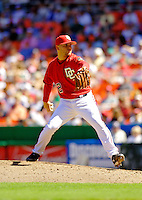 11 June 2006: Saul Rivera, pitcher for the Washington Nationals, winds up on the mound against the Philadelphia Phillies at RFK Stadium, in Washington, DC. The Nationals shut out the visiting Phillies 6-0 to take the series three games to one...Mandatory Photo Credit: Ed Wolfstein Photo..