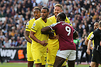 Michail Antonio of West Ham keeps a close eye on Brentford's Ivan Toney, Zanka and Pontus Jansson as they await a Bees corner during West Ham United vs Brentford, Premier League Football at The London Stadium on 3rd October 2021