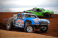 Apr 16, 2010; Surprise, AZ USA; LOORRS pro 2 unlimited driver Robby Woods (99) races inside of Justin Davis (85) during practice for round 3 at Speedworld Off Road Park. Mandatory Credit: Mark J. Rebilas-US PRESSWIRE