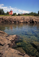 Lighthouse on rocky shore of Lake Superior at Two Harbors. Two Harbors Minnesota USA Lake Superior.