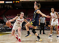 COLLEGE PARK, MD - DECEMBER 28: Taylor Mikesell #11 of Maryland holds off Amy Dilk #1 of Michigan. during a game between University of Michigan and University of Maryland at Xfinity Center on December 28, 2019 in College Park, Maryland.