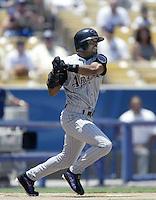 Tony Womack of the Arizona Diamondbacks bats during a 2002 MLB season game against the Los Angeles Dodgers at Dodger Stadium, in Los Angeles, California. (Larry Goren/Four Seam Images)