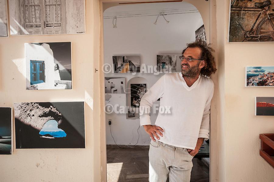 Photographer Nikos Rigopoulos in his gallery, Oia, Santorini, Greece