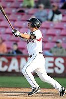 Salem-Keizer infielder Garrett Buechele #26 bats against the Eugene Emeralds at Volcanoes Stadium on August 9, 2011 in Salem-Keizer,Oregon. Eugene defeated Salem-Keizer 13-7.(Larry Goren/Four Seam Images)