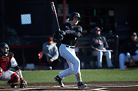 Matt Higgins (6) of the Bellarmine Knights follows through on his swing against the North Greenville Crusaders at Ashmore Park on February 7, 2020 in Tigerville, South Carolina. The Crusaders defeated the Knights 10-2. (Brian Westerholt/Four Seam Images)
