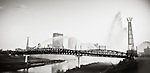 Pedestrian Bridge Riverscape in Dayton Ohio with fountains. Artistic interpretation