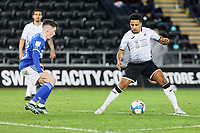 (L-R) Harry Wilson of Cardiff City and Korey Smith of Swansea City in action during the Sky Bet Championship match between Swansea City and Cardiff City at the Liberty Stadium, Swansea, Wales, UK. Saturday 20 March 2021