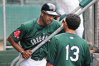 Manager Billy McMillon (51) of the Greenville Drive talks with second baseman Kenneth Roque (13) in the dugout during a game against the West Virginia Power May 2, 2010, at Fluor Field at the West End in Greenville, S.C. Photo by: Tom Priddy/Four Seam Images