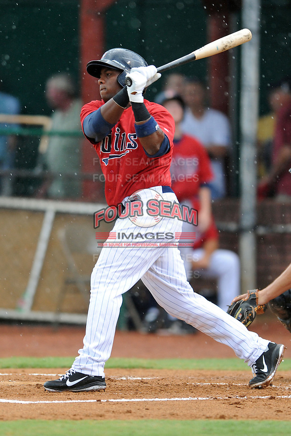 Elizabethton Twins right fielder Kelvin Ortiz #15 swings at a pitch during a game against the Bristol White Sox at Joe O'Brien Field on June 20, 2013 in Elizabethton, Tennessee. The Twins won the game 3-0. (Tony Farlow/Four Seam Images)