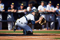 Michigan Wolverines catcher Harrison Salter (11) waits for a throw from right fielder Christan Bullock (not shown) during a game against Army West Point on February 18, 2018 at Tradition Field in St. Lucie, Florida.  Michigan defeated Army 7-3.  (Mike Janes/Four Seam Images)