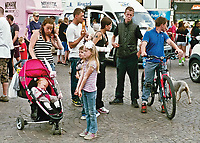 """The people of Newark await the arrival of Queen Aimee Bridgett. <br /> <br /> """"Amid a sea of colour, the air was full of music and expectant crowds lined the route as the floats passed by followed by scores of children on foot."""""""