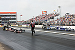 Brandon Bernstein (7) drive for the Copart Top Fuel Dragster team and Steve Torrence (8) driver for the Capco Contractors Inc. team make a run at the O'Reilly Auto Parts Spring Nationals Finals at the Royal Purple Raceway in Baytown,Texas.