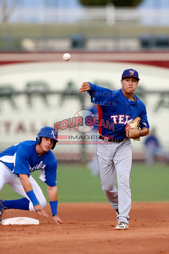 Isiah Kiner-Falefa #5 of the AZL Rangers throws to third base after forcing out at second base Brandon Dulin #13 of the AZL Royals during a game at Surprise Stadium on July 15, 2013 in Surprise, Arizona. AZL Rangers defeated the AZL Royals, 3-2. (Larry Goren/Four Seam Images)