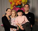 Stephanie and Bryan Magers with Kinsey,4 and Grayson,4,  at the MD Anderson Children's Cancer Hospital, Bunny Hops and Photo Ops at The Galleria Saturday March 21,2016.(Dave Rossman Photo)
