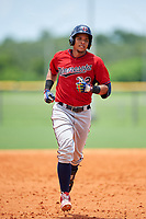 GCL Twins third baseman Roni Tapia (32) rounds the bases after hitting a home run in the bottom of the seventh inning during the first game of a doubleheader against the GCL Rays on July 18, 2017 at Charlotte Sports Park in Port Charlotte, Florida.  GCL Twins defeated the GCL Rays 11-5 in a continuation of a game that was suspended on July 17th at CenturyLink Sports Complex in Fort Myers, Florida due to inclement weather.  (Mike Janes/Four Seam Images)