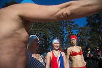 Moscow, Russia, 08/03/2010..Women of the Moscow Ice Swimming Club wait to enter the water while celebrating International Women's Day with a swim and party at a frozen lake in northern Moscow. The club always hold their end of season party on Women's Day.