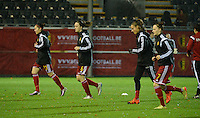 20151130 - LEUVEN ,  BELGIUM : Belgian players pictured during the warming up of the female soccer game between the Belgian Red Flames and Serbia , the third game in the qualification for the European Championship in The Netherlands 2017  , Monday 30 November 2015 at Stadion Den Dreef  in Leuven , Belgium. PHOTO DIRK VUYLSTEKE