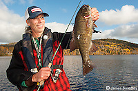 Man with smallmouth bass