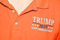 A man wears a Trump 2020 Keep America Great facemask and polo shirt as people gather for a Trump campaign office opening party in Salem, New Hampshire, on Fri., Sept. 18, 2020. Former 2016 Trump campaign manager and current 2020 Trump campaign senior advisor Corey Lewandowski, lives in nearby Windham, NH, spoke at the event, which also doubled as a surprise birthday celebration for Lewandowski.