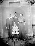 """THE TALBERT FAMILY. Rev. Albert W. Talbert (1859-?), his wife Mildred (1874-1960), son Dakota (1898-1968), and daughter Ruth (1906-2005) pose in front of Newman Methodist Episcopal Church at 733 J Street around 1914. The Talberts came to Lincoln in 1914 from Guthrie, Oklahoma, and Reverend Talbert ministered to his African American congregation until 1920. Mother Millie later worked as a hairdresser to support Ruth through Lincoln High School and as she earned a two-year teaching certification at the University of Nebraska in 1926. This image is pivotal in the understanding of this body of photographs, because the negative reached California in the collection of Douglas Keister, while an original print of the family portrait survived in the possession of Ruth Talbert (later Greene, then Folley). She told Abigail Anderson and Edward F. Zimmer in 2002, """"Mr. Johnny Johnson took our picture."""" Her oral history interviews with Anderson greatly enriched Lincoln history and this book.<br /> <br /> Photographs taken on black and white glass negatives by African American photographer(s) John Johnson and Earl McWilliams from 1910 to 1925 in Lincoln, Nebraska. Douglas Keister has 280 5x7 glass negatives taken by these photographers. Larger scans available on request."""