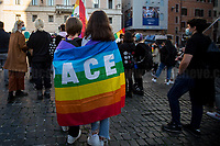 "Rome, 17/10/2020. Today, ArciGay Roma, supported by other organizations, held a demonstration outside the Pantheon in support to the so called Zan Bill Against Homotransphobia and Misogyny (1.) (DDL Zan contro l'omotransfobia e la misoginia): ""Amendments to articles 604-bis and 604-ter of the penal code, on violence or discrimination on grounds of sexual orientation or gender identity"" (569) (Proposta di legge: ZAN: ""Modifiche agli articoli 604-bis e 604-ter del codice penale, in materia di violenza o discriminazione per motivi di orientamento sessuale o identità di genere"" [569]), proposed by Democratic Party (PD) Alessandro Zan MP. From the organisers Facebook event page (2.): «[…] These days the Parliament is engaged in the discussion of the bill against homotransphobia and misogyny. The time has come for Italy to follow the example of other European countries. For too many years we have been waiting for a serious and effective law to fight violence and discrimination against LGBT+ people and women, protecting the victims with adequate resources and concrete policies. You can no longer turn your head away. Time to stop the hate […]».<br />