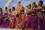 Hindu puberty coming of age party, Mitcham London 2016.  Sixteen year of with her young Maids of Honour,