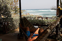 Joe  relaxing at Surfers Point ..Barbados , Easter 2010 ..pic copyright Steve Behr / Stockfile