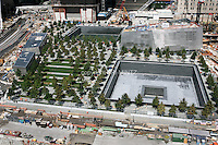 Tenth anniversary of 9/11.  Rebuilding at the World Trade Center site.   The 9/11 Memorial is situated around the footprints of the original towers.   Photo by Ari Mintz.  8/22/2011.